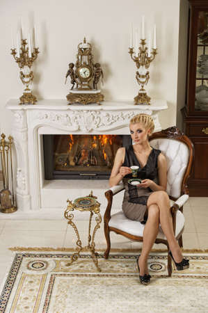 Beautiful blond woman in a luxury interior photo