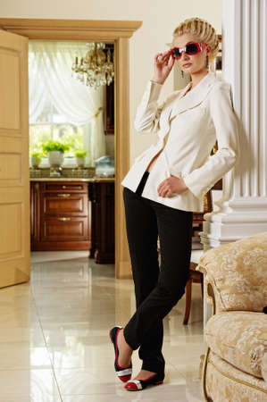 Beautiful blond woman in a luxury interior Stock Photo - 9904813