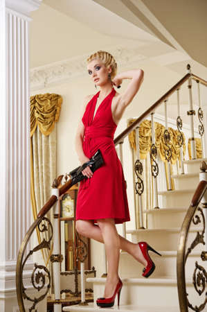 Beautiful blond woman on the stairs photo