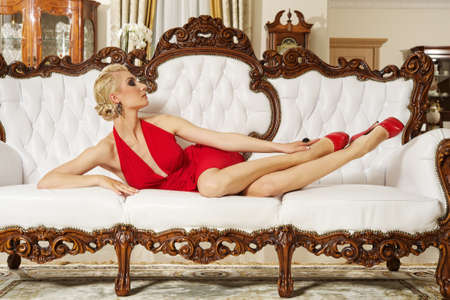Beautiful blond woman in a luxury interior Stock Photo - 9657933