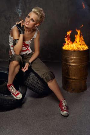 Punk girl smoking a cigarette Stock Photo - 9657903