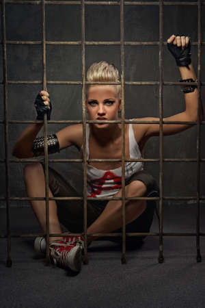 Punk girl behind bars Stock Photo - 9657699