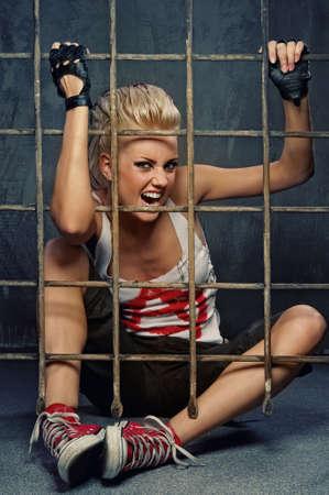 Punk girl behind bars photo