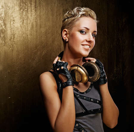 Attractive steam punk girl with headphones smiling photo
