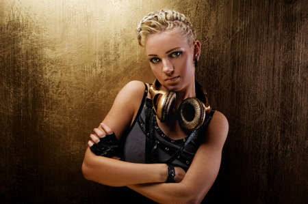 Attractive steam punk girl with headphones photo
