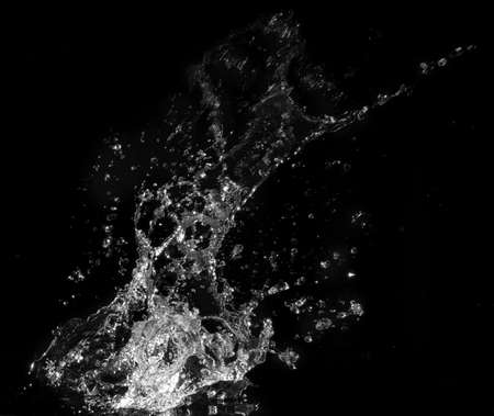 Water splash isolated on black background photo