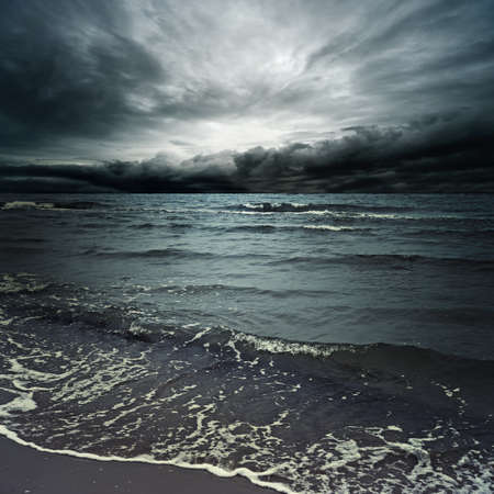Stormy clouds over dark ocean photo