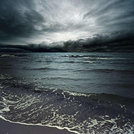 Stormy clouds over dark ocean Stock Photo - 9732902