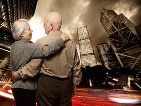 Senior couple looking at modern city photo