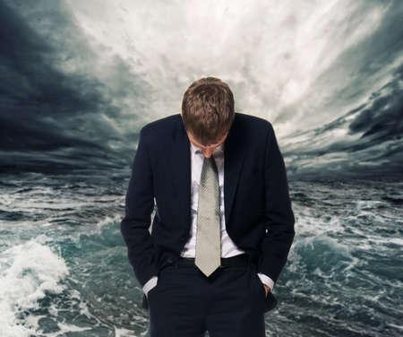 tsunami wave: Ocean storm behind businessman  Stock Photo