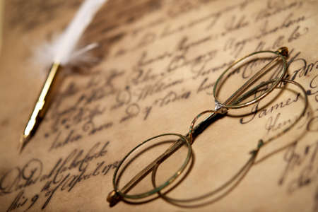 Old glasses on vintage letter photo