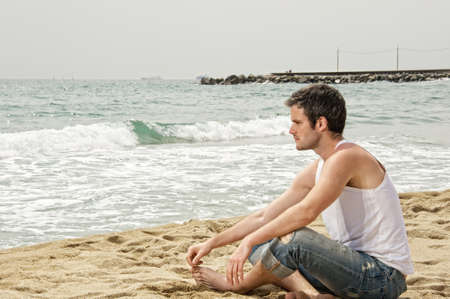Handsome man looking at a sea photo