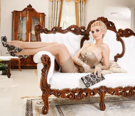 antique woman: Beautiful blond woman in luxury interrior