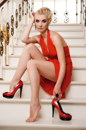 dress shoe: Blond lady sitting on a stairs