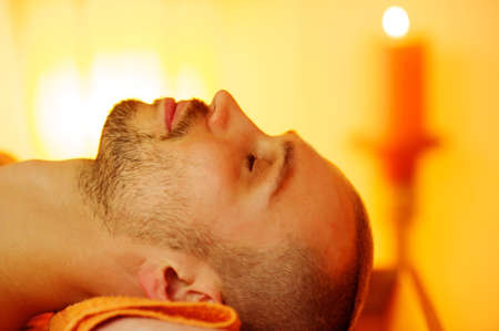 Man relaxing after massage photo