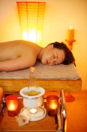 Woman relaxing in massage salon photo