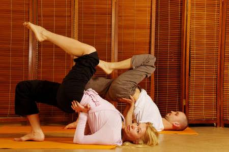 Couple doing yoga exercise photo