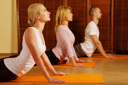 female pose: Group doing yoga exercise