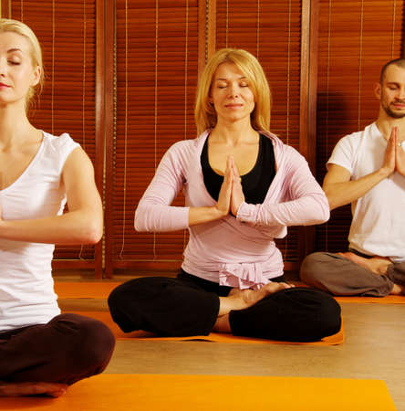 Group of people meditating photo