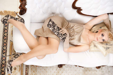 sexy shoes: Beautiful blond woman in a luxury interior
