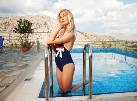 Pin up girl near swimming pool photo