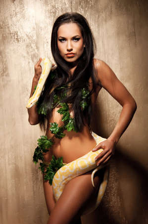 albino: Attractive brunette woman with albino python