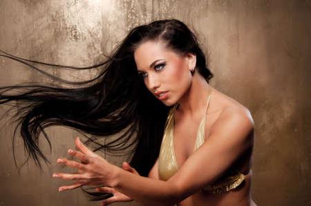 summoning: Beautiful woman in bikini performing ritual dance