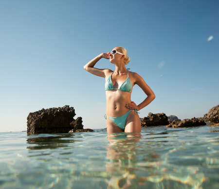 swimming suit: Beautiful woman standing in a water Stock Photo