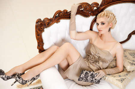 Beautiful blond woman in a luxury interior Stock Photo - 9999454