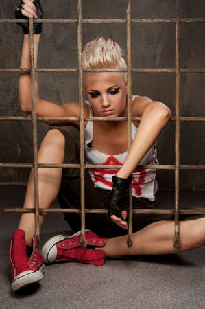 Punk girl behind bars. photo