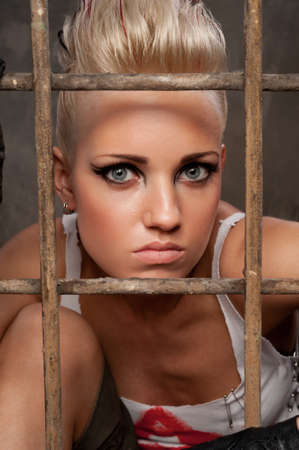 Portrait of a punk girl behind bars. Stock Photo - 10015443