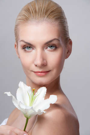 Beautiful blond woman with white lily flower photo