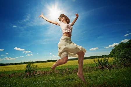 woman jumping: Beautiful woman in cowboy hat jumping.