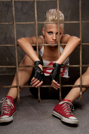 Punk girl behind bars. Stock Photo - 9999484
