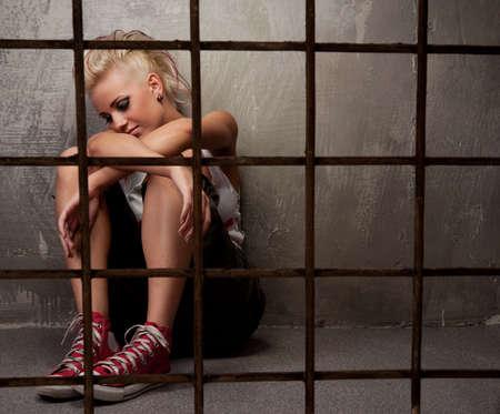 Punk girl behind bars. Stock Photo - 9999470