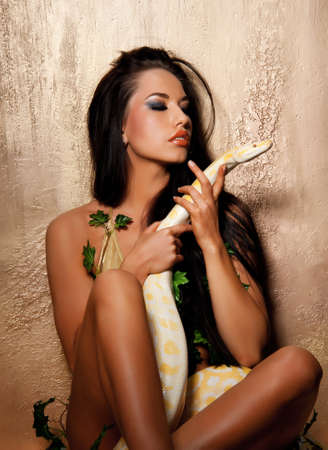 Attractive brunette woman with albino python photo