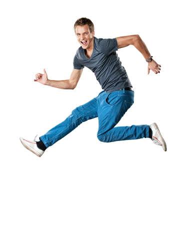 saltando: Hombre guapo saltando. Foto de archivo