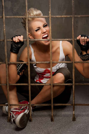 Punk girl behind bars. Stock Photo - 10015490