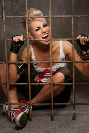 Punk girl behind bars. Stock Photo - 10015490