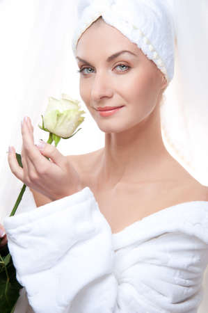 humidify: Beautiful woman after shower holding a white rose. Stock Photo