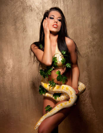 Attractive brunette woman with albino python