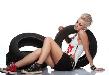 leather skirt: Punk girl with a tires. Stock Photo