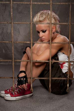 Punk girl behind bars. photo