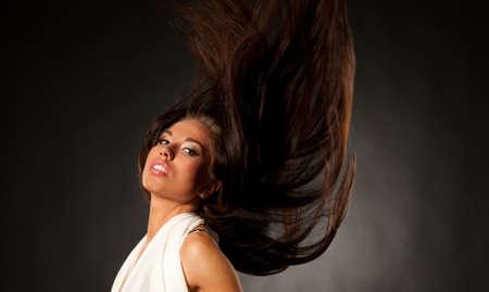 Beautiful brunette with waving hair photo