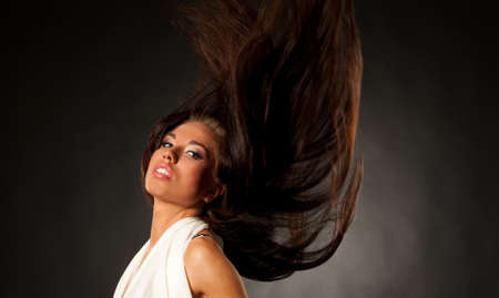 Beautiful brunette with waving hair Stock Photo