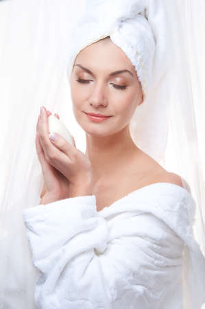 humidify: Beautiful woman after shower holding a soap Stock Photo