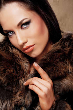Close-up portrait of an attractive brunette woman Stock Photo - 10015569