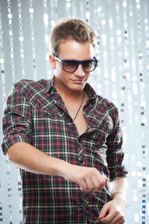 shades of grey: Stylish young man in a night club. Stock Photo