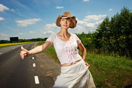 belle: Hitchhiker girl in cowboy hat. Stock Photo