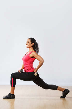 Beautiful woman exercising in fitness club. Stock Photo - 10199620